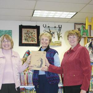Connie Osterman donates Acme History Book