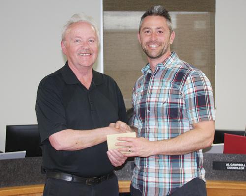 Jr. Achievement Coordinator presents to Town Council